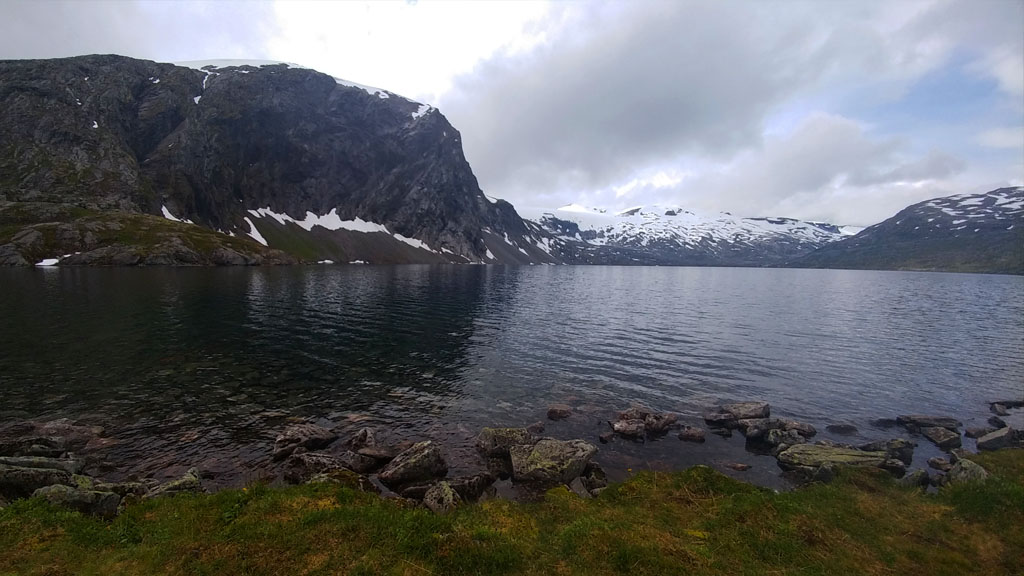 Icy mountain peaks and hillsides enveloped Djupvatnet lake