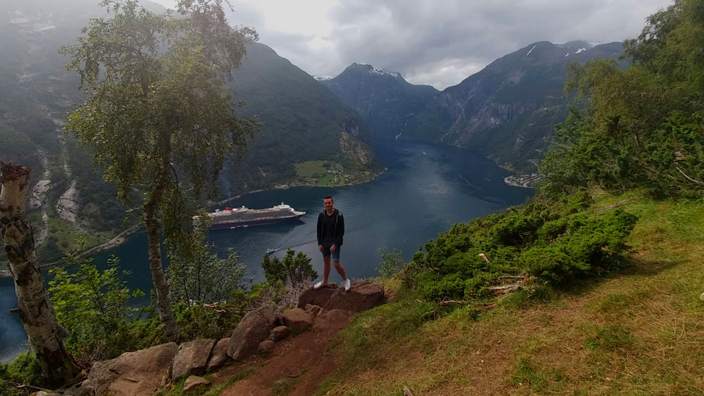 Standing tall, conquering Norway's most famous fjord, legs at a slightly strange angle