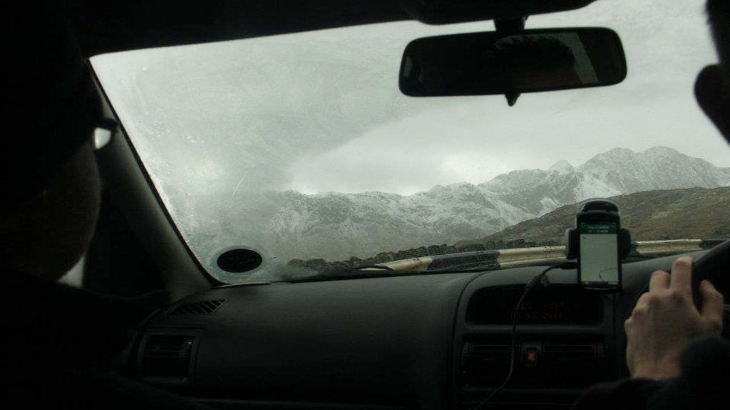 The view from within our car, through an iced-up windscreen observing the miserable conditions near Mount Snowdon.