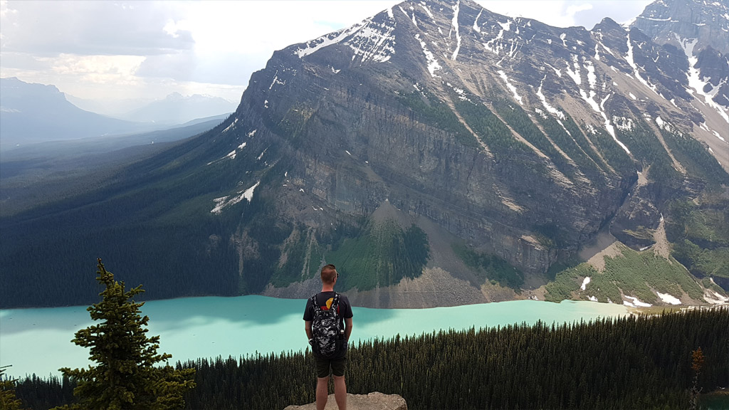 Standing before some sensational scenery a-top of the Little Beehive, looking down on Lake Louise.