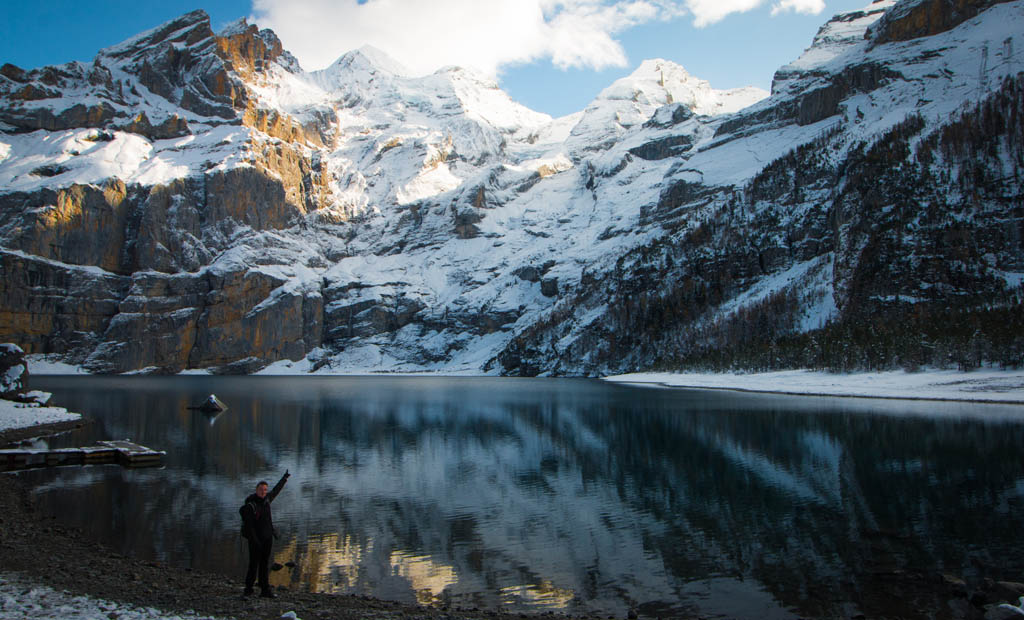 Obligatory 'point at the thing you worked hard to see' pose shore-side at Oeschinen Lake